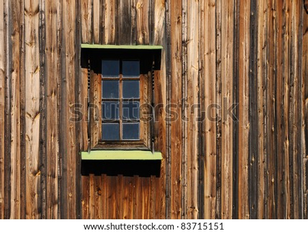 Old wooden building close up of a wall with a window