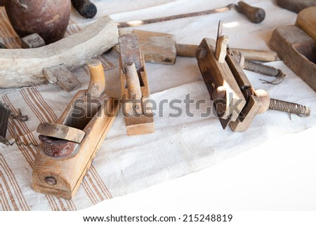 old wooden carpentry planers with selective focus - stock photo