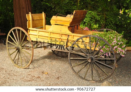 Old wooden carriage in the garden