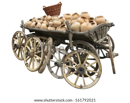 Old wooden cart full of clay pottery, wheels and wicker basket isolated over white background - stock photo