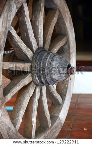 Old wooden cartwheel. - stock photo