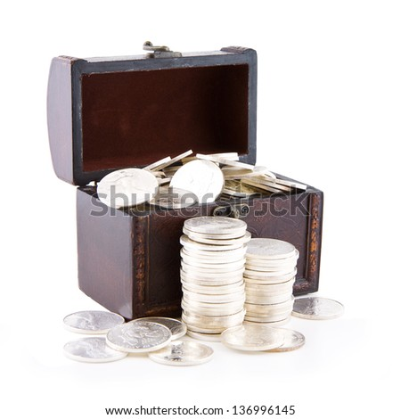 Old wooden case full of silver coins, isolated on white - stock photo