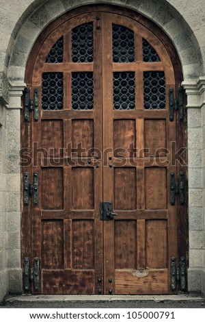 Old Wooden Cathedral Door - stock photo