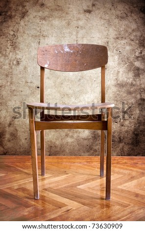 old wooden chair in a dirty room - stock photo