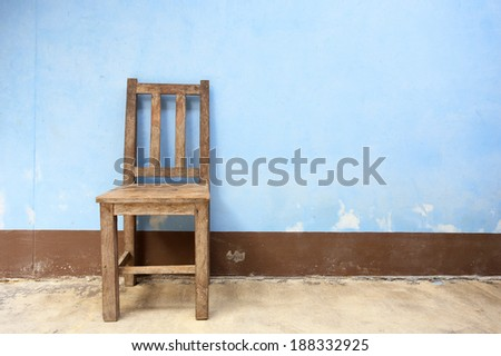 Old Wooden Chair in Abandoned Building  - stock photo
