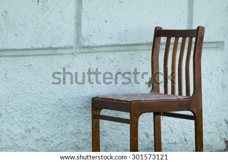 Old wooden chair on a white background gray wall