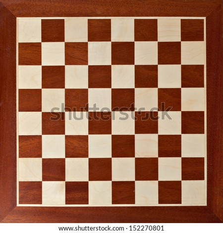 Old wooden chess board - stock photo