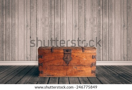 Old wooden chest with closed lit - stock photo