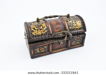 Old wooden chest with decorations. Used to store expensive things, jewelry, letters. Made of wood, it looks old-fashioned. In the history it is used for keeping things with large values.