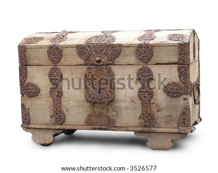 Old wooden chest with ornamental iron fittings over white background - stock photo