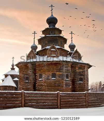 old wooden church against the evening sky - stock photo