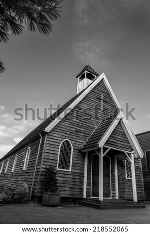 old wooden church canadian or american style, black and white.