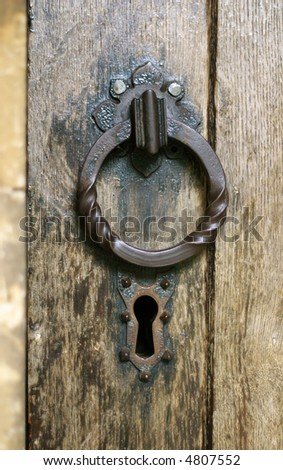 old wooden church door with iron cast lock and handle