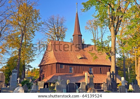 Old wooden church during the autumn time. - stock photo