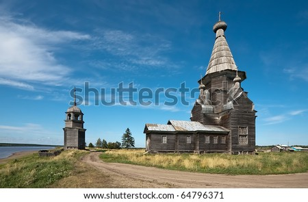 old wooden church in Russian village, summer view - stock photo