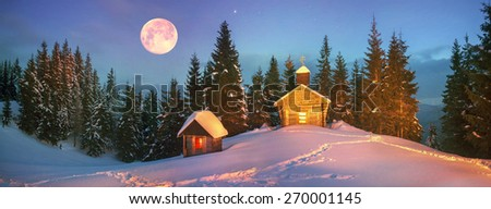 Old wooden church, located in the Carpathian Mountains on the ridge Chornohora, wild reserved place. Powerful flashlight helps illuminate the mountain slopes for unique photos - stock photo