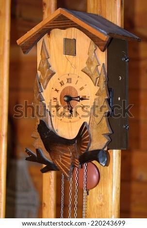old wooden clock  cuckoo - stock photo