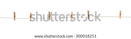 Old wooden clothespins on a rope isolated on  white background - stock photo