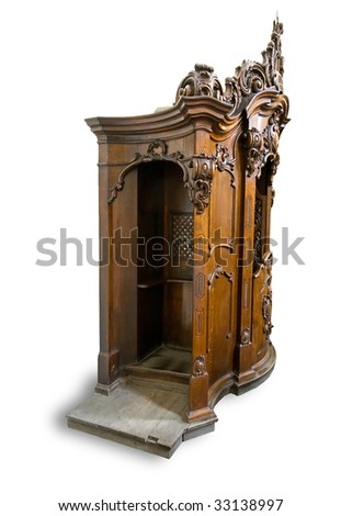 Old wooden confessional isolated on white background