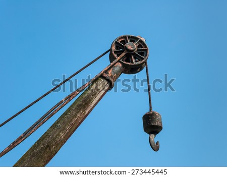 Old wooden crane detail. - stock photo