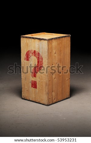 Old wooden crate with a photoshopped question mark on dirty concrete floor. - stock photo