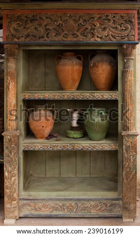 Old wooden crockery with pottery  and lamp  - stock photo