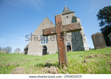 old wooden cross in a church graveyard - stock photo