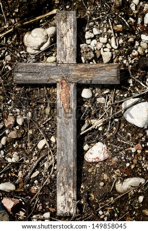 Old wooden cross lying on a ground - stock photo