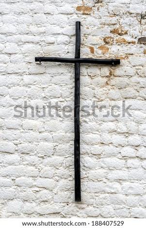 Old wooden cross on an old white wall at Santo Ecce Homo Monastery near Villa de Leyva, Colombia - stock photo
