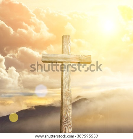 Old wooden cross on blue sky background - stock photo