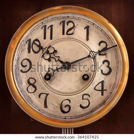 Old wooden cuckoo clock, manufactured at the beginning of the 20th century. - stock photo