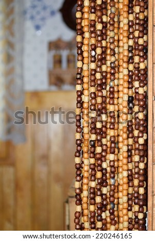 Old wooden curtain of beads in the kitchen.  - stock photo