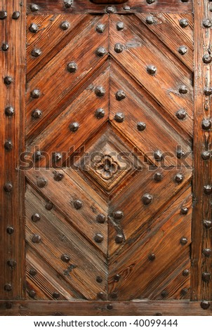 Old wooden decorative door. Ornamental vintage architecture details.
