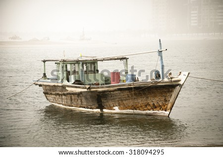Old wooden dhow parked in the water. - stock photo