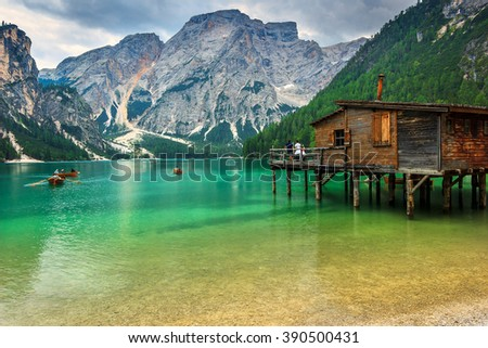 Old wooden dock house on the lake with typical wooden boats,Braies lake,Dolomites,Italy,Europe - stock photo