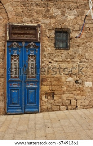 Old wooden door and a window - stock photo