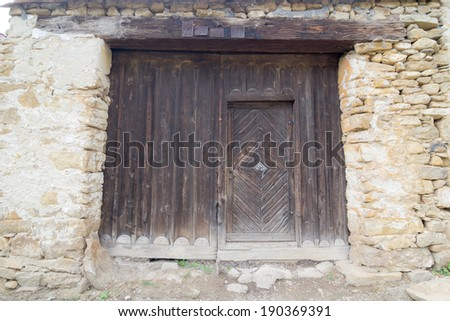 Old, wooden door and concrete and brick wall