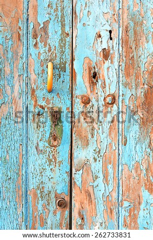 Old wooden door and keyhole detail