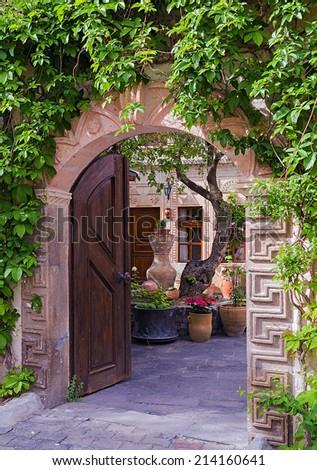 old wooden door at a hotel in Cappadocia - stock photo