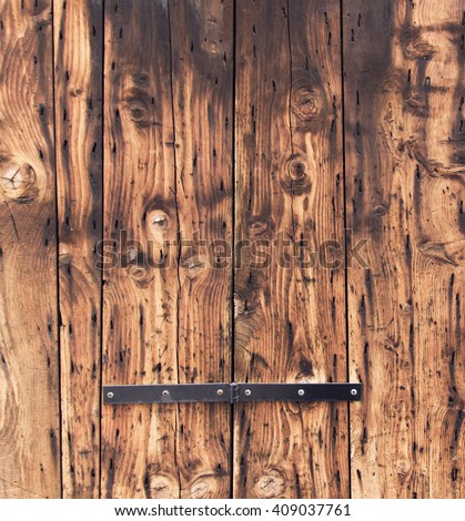 old wooden door background. closeup, natural oak tree planks surface. weathered, rustic wood material. brown color textured wallpaper. exterior timber board - stock photo