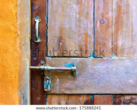 Old wooden door detail - stock photo