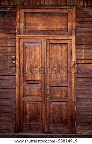 Old wooden door front view - stock photo