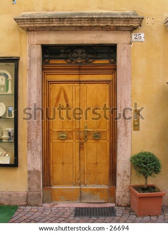 Old wooden door in a stone building with bell