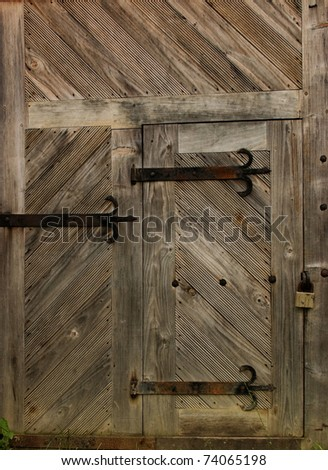 Old wooden door in an old barn - stock photo
