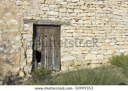 old wooden door in an old country house - stock photo