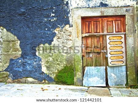 Old wooden door in Portugal. Porto. - stock photo