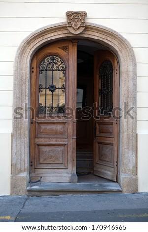 Old wooden door in Upper Town of Zagreb, Croatia - stock photo