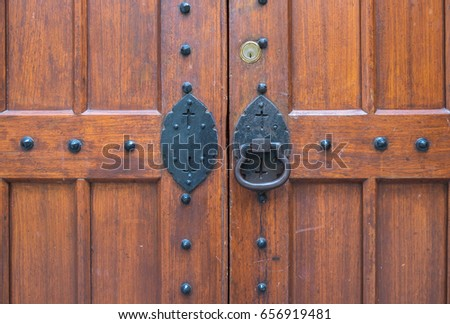 Old Wooden Door Of Christian Chapel. Hand Forging Iron Lock And Handle In  The Center