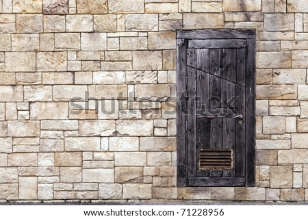 Old Wooden Door on Grunge Brick Wall - stock photo