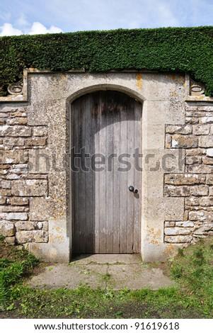 Old Wooden Door to a Garden - stock photo